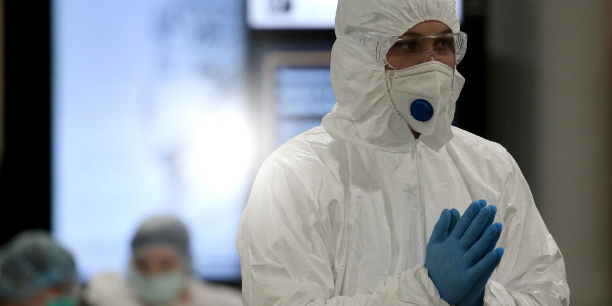 MOSCOW REGION, RUSSIA - MARCH 19, 2020: A medical staff member in a protective suit ready ready to check passengers arriving at Sheremetyevo International Airport from Berlin, to prevent the spread of the viral diseases. Marina Lystseva/TASS  Ðîññèÿ. Ìîñêîâñêàÿ îáëàñòü. Ìåäðàáîòíèê àýðîïîðòà Øåðåìåòüåâî â ìåäèöèíñêîé ìàñêå ïåðåä îñìîòðîì ïðèáûâøèõ ïàññàæèðîâ èç Áåðëèíà. Ìàðèíà Ëûñöåâà/ÒÀÑÑ